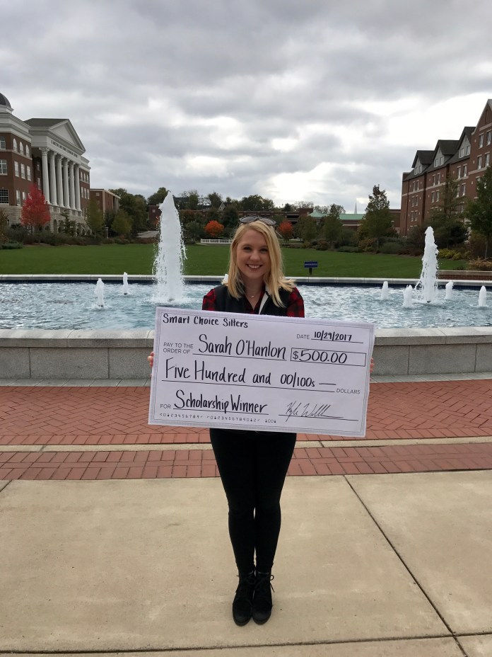 Sarah O'Hanlon holding over-sized scholarship check