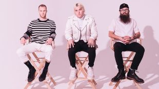 members of Judah and the Lion sitting in directors chairs, staring at the camera