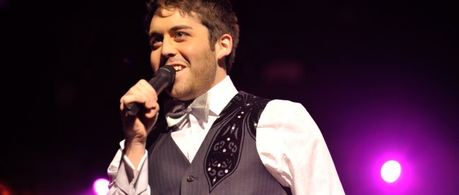 Brett Mclaughlin performing on stage