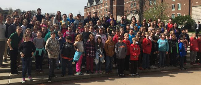 large group of fourth graders with their teachers, standing in front of the fountain