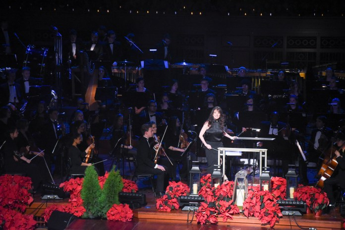 """Jo Lynn taking the stage at the Schermerhorn Symphony Center for Musical Theatre's performance of """"Snow"""" from White Christmas for the 2018 taping of Christmas at Belmont"""