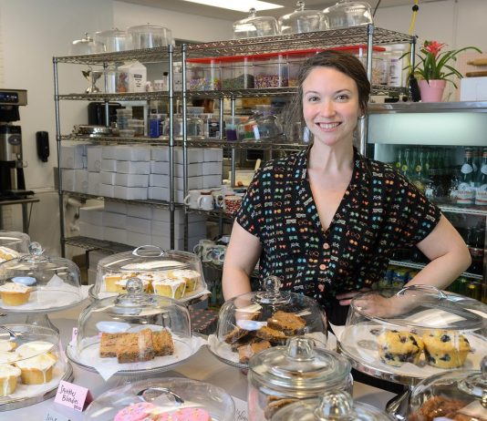 Belmont grad Leah Carmean, owner of Baked on 8th bakery, poses in her new store near Belmont University in Nashville, Tennessee, July 31, 2018.