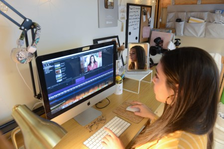 Hannah Ashton Rodriguez works on video edits in her residence hall.