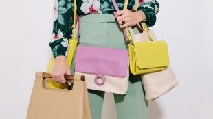 Model poses with purses in Payton James Spring 2019 line