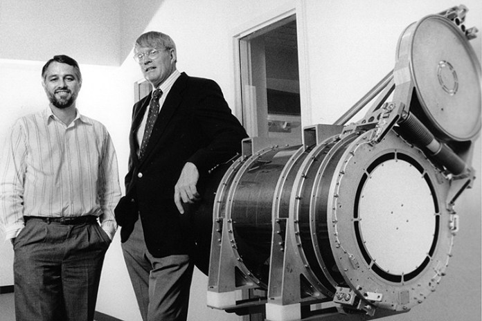 Stuart Bowyer and Roger Malina with model of EUVE satellite