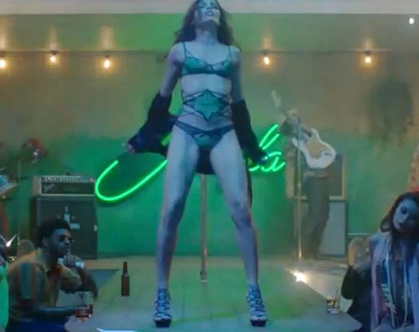 Freida Pinto strips down for Bruno Mars in Music Video