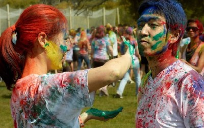 Girl applying Color to a Boy on Holi Festival