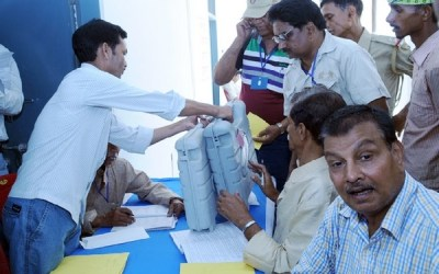 Polling officials collecting the Electronic Voting Machines (EVMs) and other necessary belongings for use in the General Elections-2014, at the distribution centre, in Chhapra, Bihar on May 06, 2014.