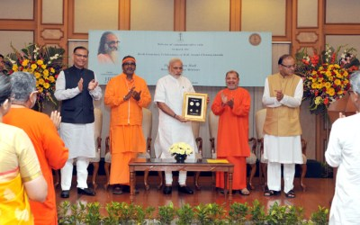 Narendra Modi releasing a commemorative coin to mark the birth centenary of Swami Chinmayananda, at a function, in New Delhi on May 08, 2015
