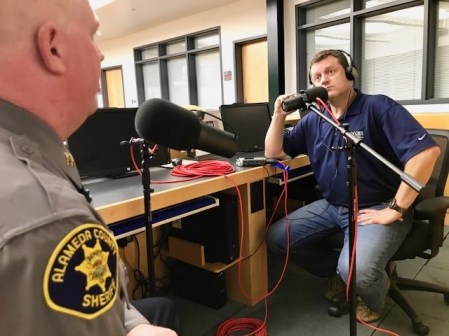 Shawn Boyd listens to Captain Stokes talk about Ghost Ship Fire