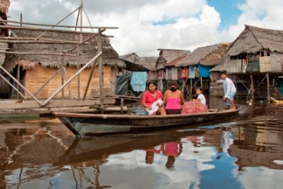 women at a floating market