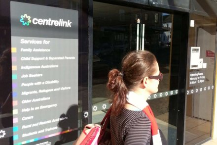 A woman walks past the Centrelink office in Marrickville, Sydney