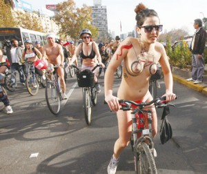 Naked cyclists ride through the city to demand for more bicycle lanes and better treatment from motorists, in Santiago