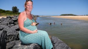 8 months pregnant NSW woman rescues two boys who have fallen into the sea
