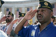 Veterans from the American Legion Post Thurmont, Maryland, salute during Veteran's Day ceremonies, Saturday, November 11, 2006, at Arlington National Cemetery. (Courtesy Bush White House Archives)