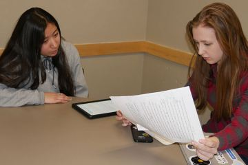 Miriam Rojo-Gutierrez watches as Katie Murphy reviews her writing