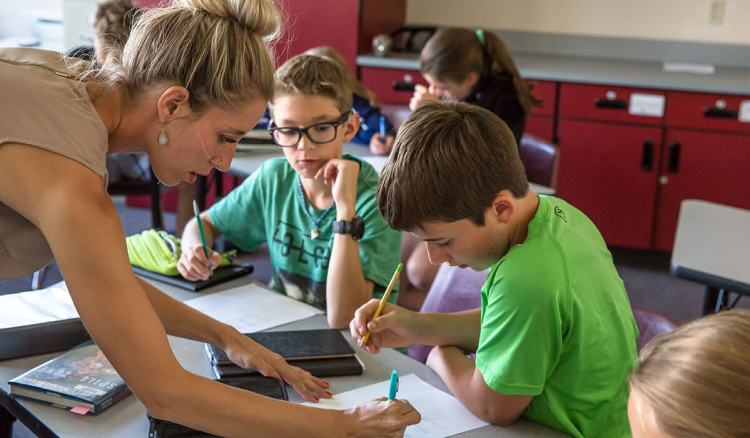 Middle School math teacher works with students