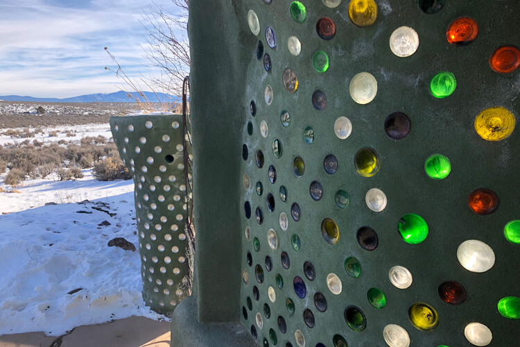 Exterior wall, recycled glass bottles. Photo by Adam Meltzer