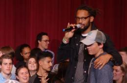 PlatFORUM keynote speaker Stephen Brackett, a social activist and lead singer of Denver-based Flobots, rallies CA Upper School student to cheer each other loudly in a game of rock-paper-scissors.
