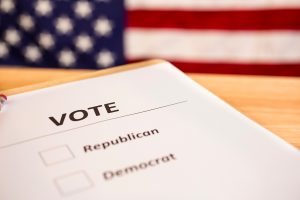 Image of a piece of paper with 'VOTE Republican or Democrat' on it and 2 checkboxes for each