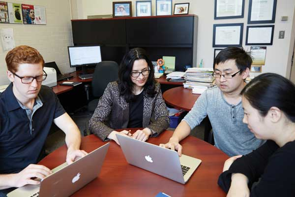 Left to right: Team members Miles Montgomery, Professor Milica Radisic, Boyang Zhang and Yimu Zhao (Photo: Geoff George)