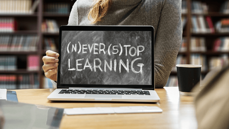 """Image of a laptop monitor that reads """"never stop learning"""" to represent an eLearning website"""