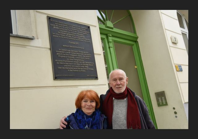 Joachim and Eveline Rudolph standing outside the flat which the tunnel came out under