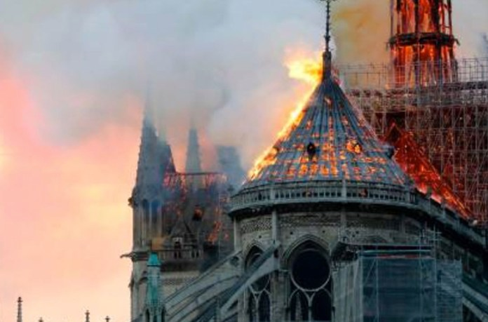 Picture of Notre Dame with the tower on fire