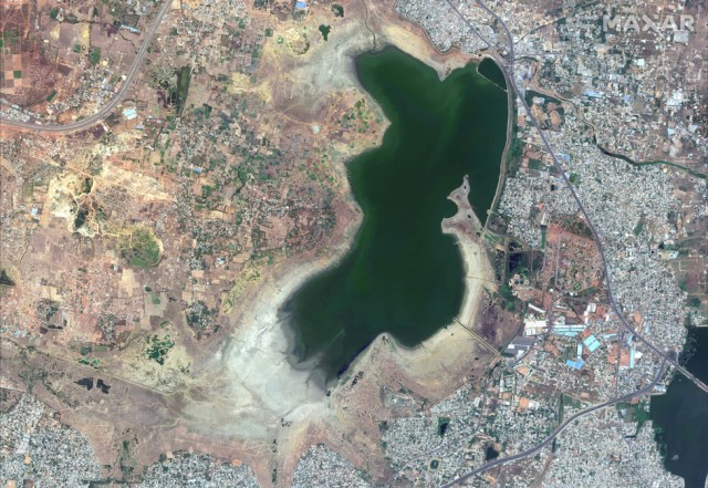 The Puzhal reservoir appears to be half empty in this satellite photograph, with large areas of brown dust or mud visible in this April 2019 image