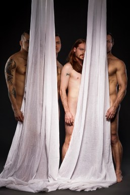 nude men obscured by hanging sheets