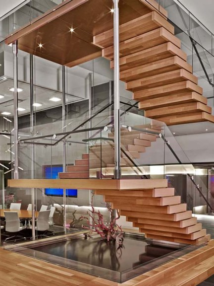 Of all her creations, she most adores this wooden staircase, hovering above a koi pond, that connects the various units within marketing conglomerate CMG's New York headquarters. The construction is highly technical, but, encased in wood, it looks almost handwrought.