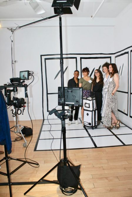 guests pose in front of Rethink Connect photo booth