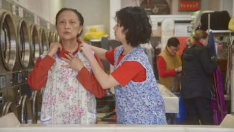 still from The Washing Society with two laundry employees
