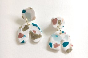 """Another trend Johnson has spotted is terrazzo, a scattered marbled tile generally found in kitchen flooring or splash walls. """"It was very popular in the '70s, but now it's being incorporated in jewelry and home decor pieces,"""" she says. Terrazzo Earrings, $35"""