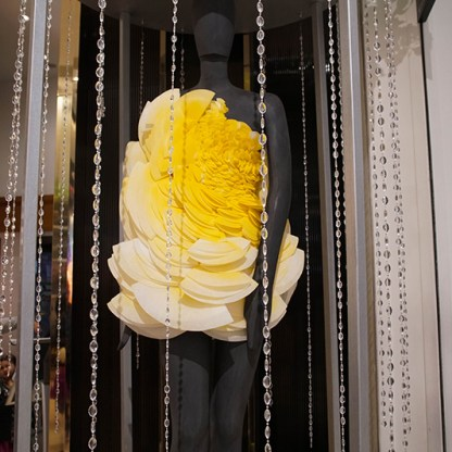Big Bang: A bright yellow petal dress designed by fourth-semester Fashion Design student Francesco Rende Fragrance: Daisy by Marc Jacobs, selected by Margaret O'Connell, a sixth-semester Cosmetics and Fragrance Marketing student