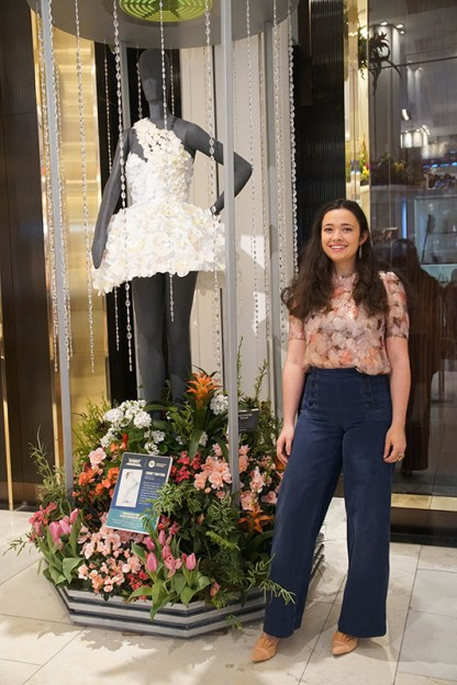 Comet Couture: A white-and-peach dress with 6,000 hand-cut petals, designed by Mary Perrone, a fourth-semester Fashion Design student. Fragrance: Chloé Nomade by Chloé, selected by Aniyah Smith, a sixth-semester Cosmetics and Fragrance Marketing student