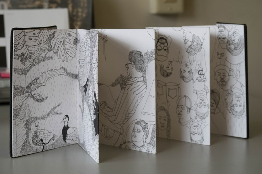 notebook with pen and ink line drawings