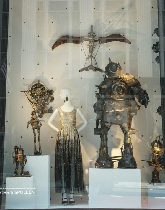 mannequin in sequined dress and metal robot sculptures
