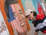 Student painting mural of President Obama