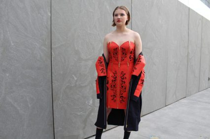 model wearing dress of dre orange material with cut outs