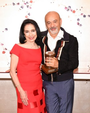 President Brown with Christian Louboutin in 2019.