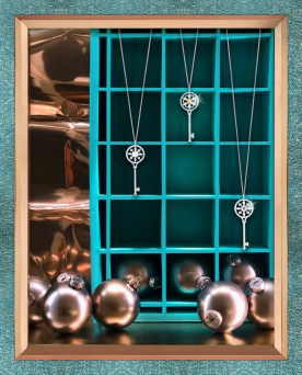 Ornamental keys hanging in a window display