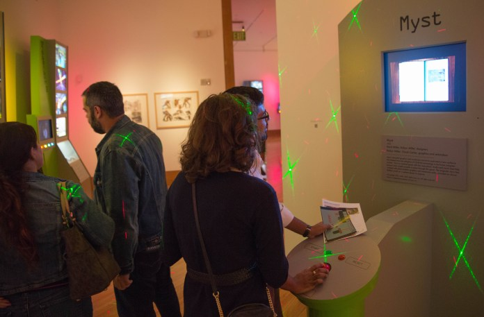 Visitors at the opening of The Art of Video Games exhibit at the Frost Art Museum enjoyed the arcade feeling of the exhibit