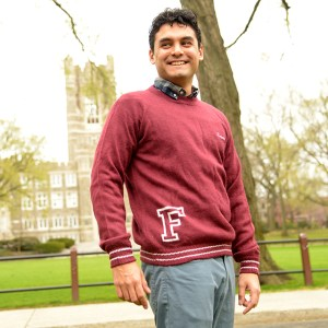 A sweater made by domestic abuse survivors in Bolivia is modeled by economics PhD candidate Walter Bazan.
