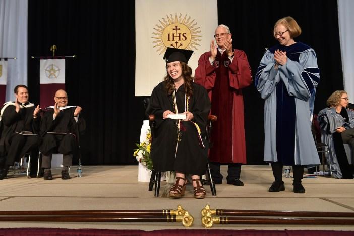 Erin Shanahan, who was awarded the Fordham College Alumni Association Award, Thomas Scirghi, SJ, and Maura Mast