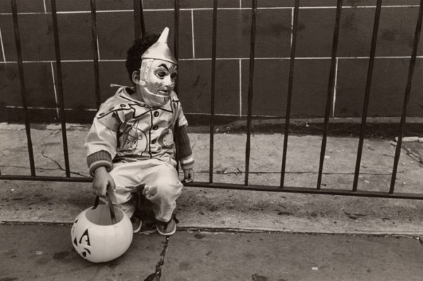 A young boy dressed up for Halloween in a Tin Man costume