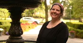 Keri Walsh, Ph.D., associate professor of English, stands next to the fountain on the Rose Hill campus