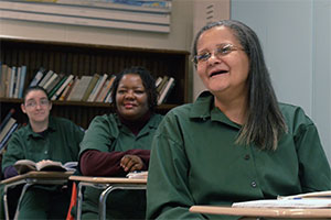 Three students in a classroom at Bedford Hills Correctional Facility, the only maximum security women's prison in New York state
