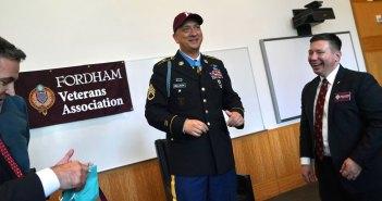 A man wearing a military uniform and a Fordham baseball cap