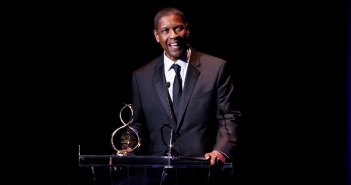 Denzel Washington receives an honor from the Crossroads Theatre Company.